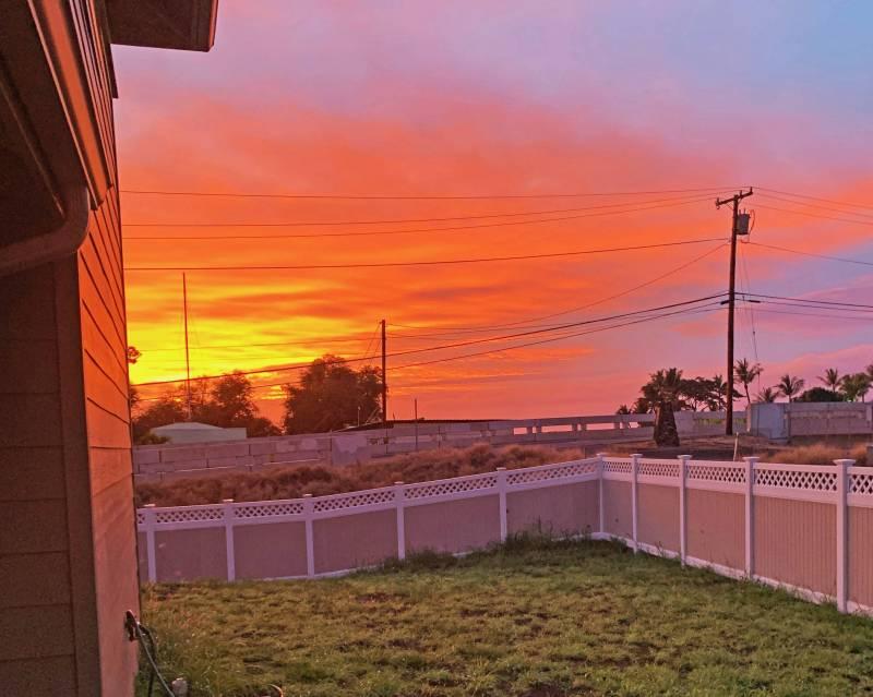 vivid orange sunset sky in west maui