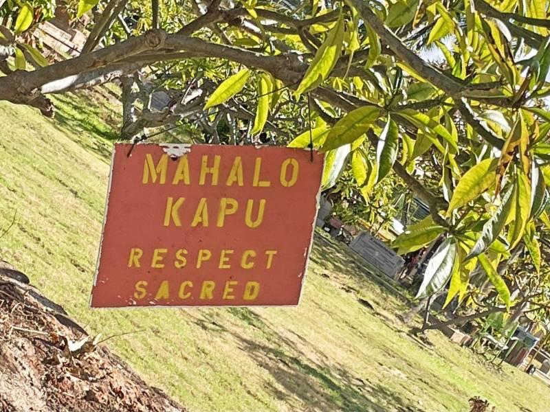 "sign reads ""mahalo kapu respect sacred"""