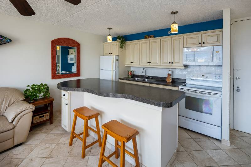 kitchen with white appliances and large island