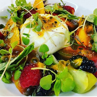 poached egg with microgreens and berries at the club at hokulia