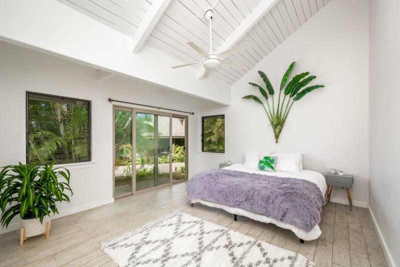 large bedroom with door to backyard