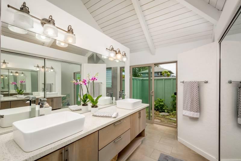 spacious master bathroom with door to backyard