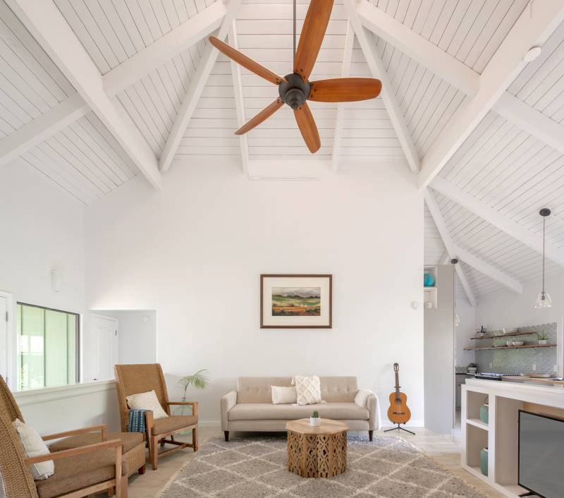 living room with high vaulted ceilings