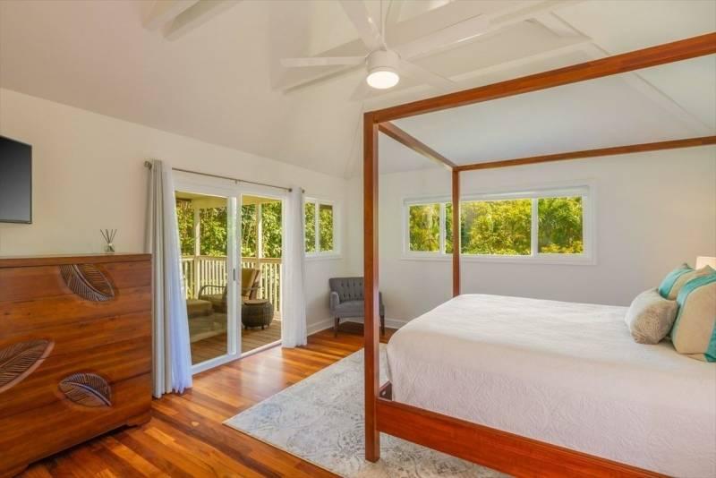 bedroom with door to lanai