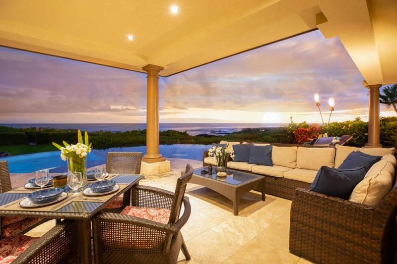 big island home with pool at dusk