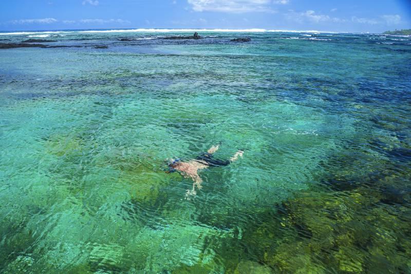 man in water big island snokeling