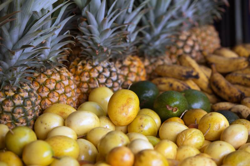 passion fruit and pineapple at a farmers market big island