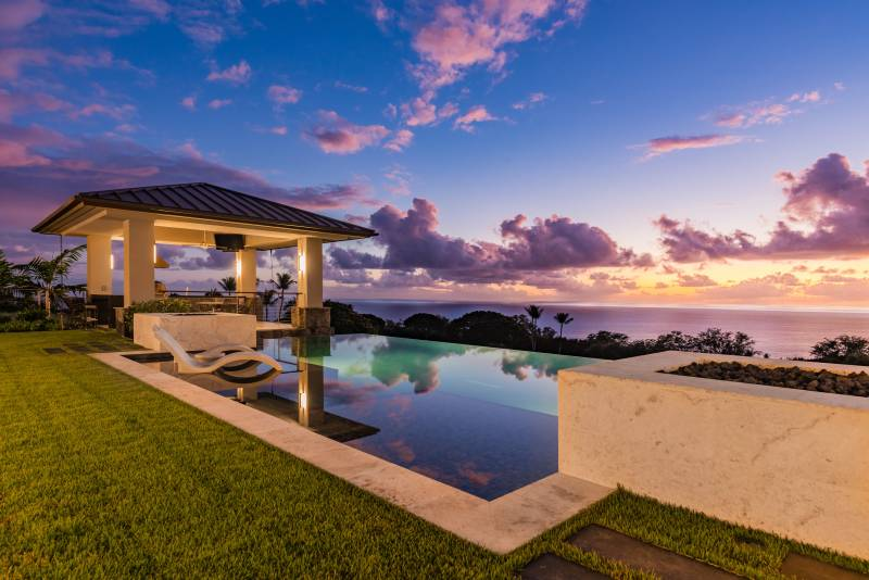 watch the sunset from your infitnity edge pool at hokulia