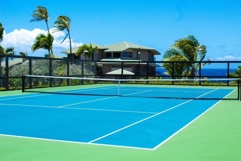 tennis court with an ocean view