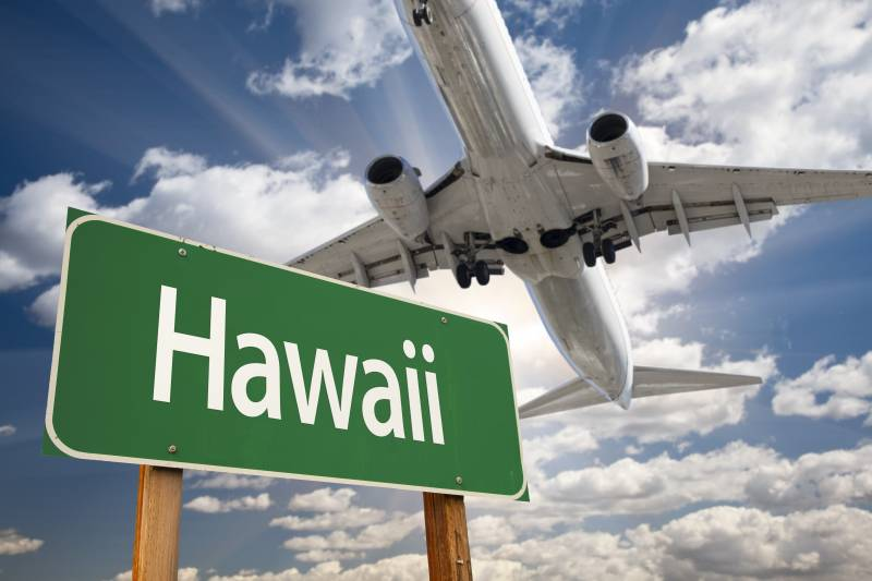 Hawaii sign with airplane