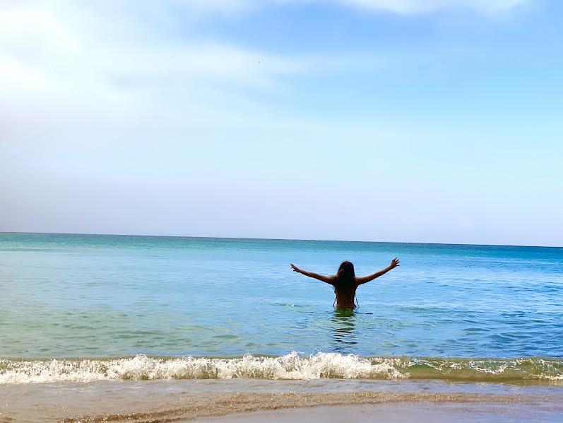 woman in ocean on big island hawaii beach