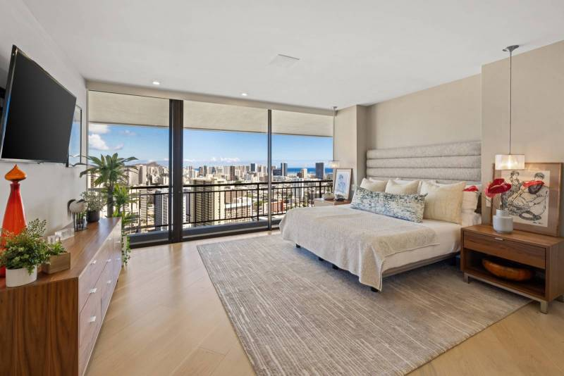 bedroom with city and ocean views