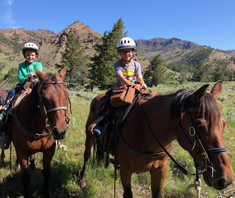 kids ride horses in maui