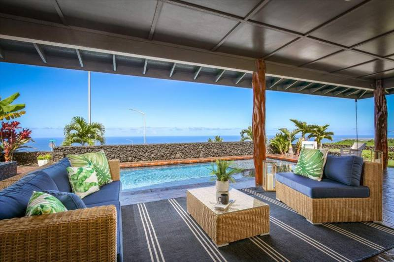 lanai overlooking pool and ocean views in the background