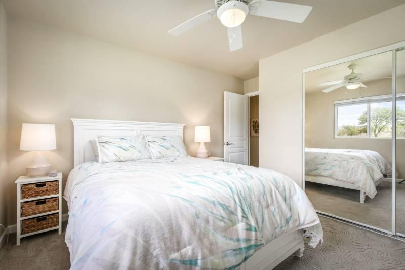 bedroom with mirrored closet doors