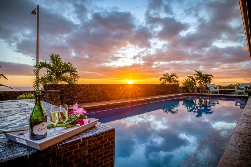 pool at sunset in kona vistas home for sale