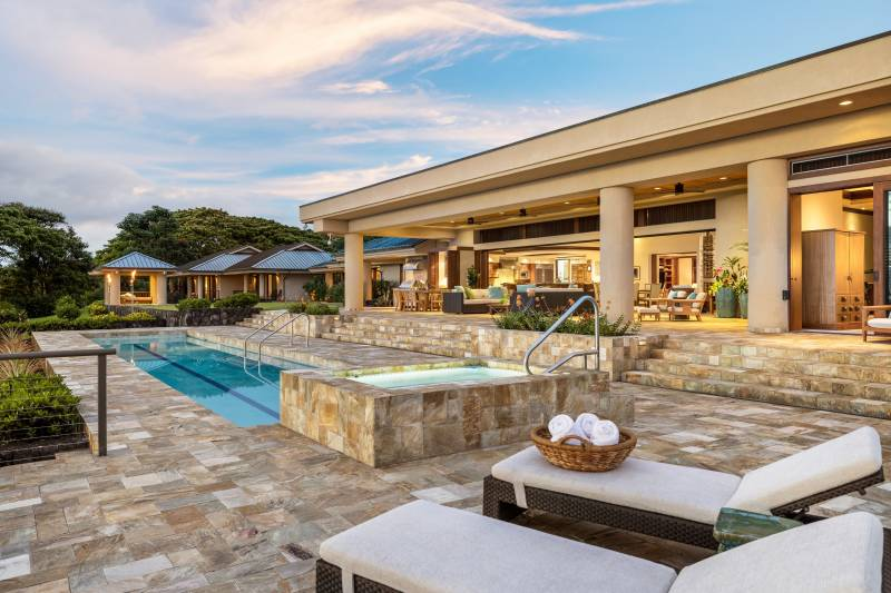 large lanai with seating and pool and spa