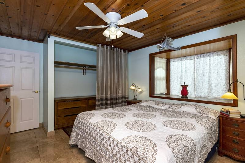 bedroom with wood paneled ceiling