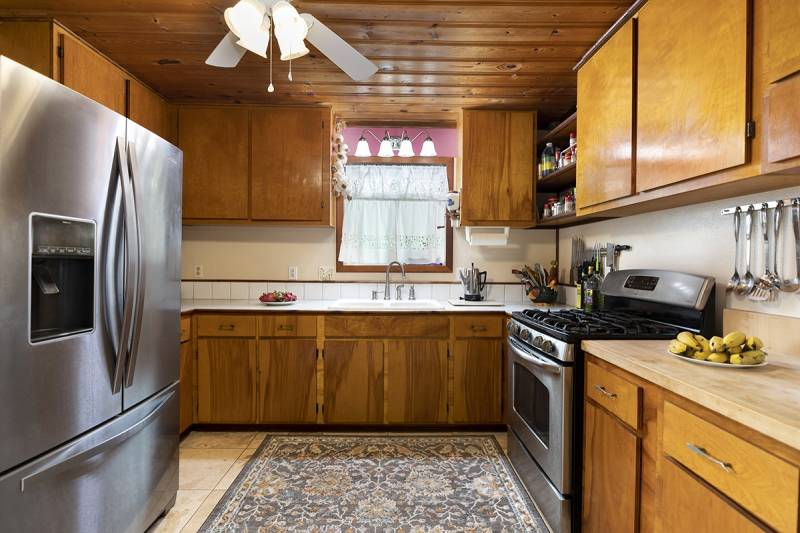 kitchen with wood cabinets and wood paneled ceilings