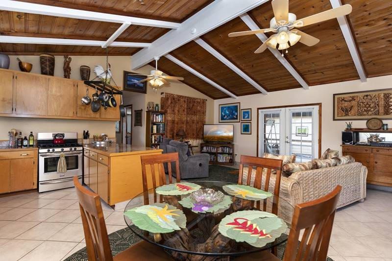 exposed beams in open kitchen dining and living room