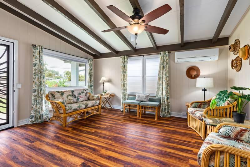 wood floors and exposed beams in living room