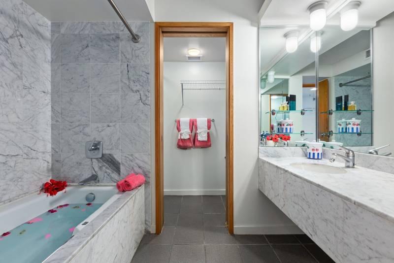 master bathroom with large bathtub