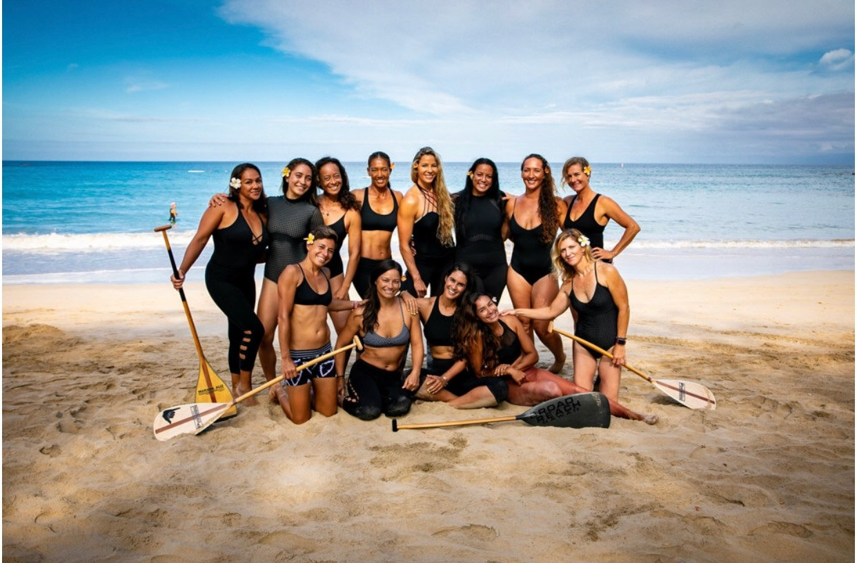 Noelani Spencer Photo_Big Island5_Outrigger Canoe Paddling Team posing on the beach in Hawaii