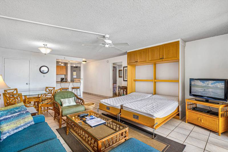 Murphy bed with two twin beds in the living room.