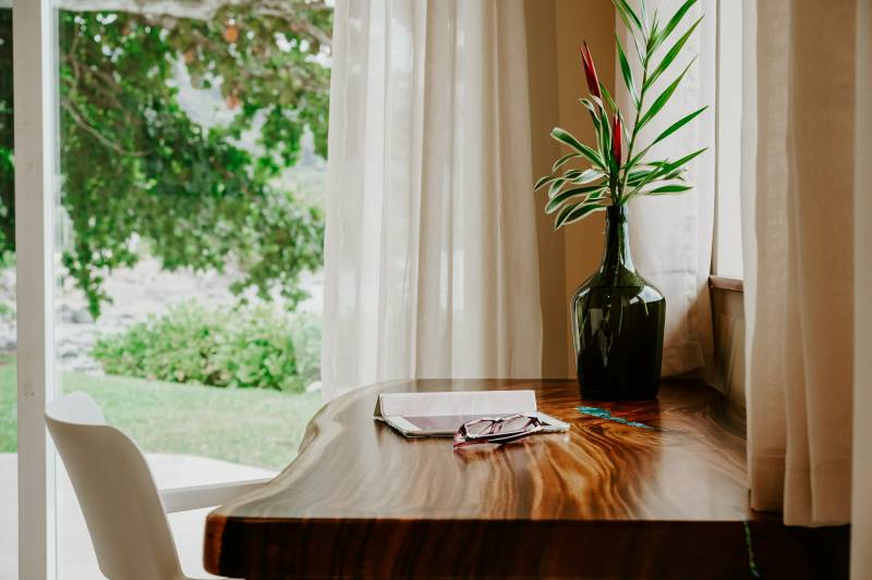 natural wood desk in front of window