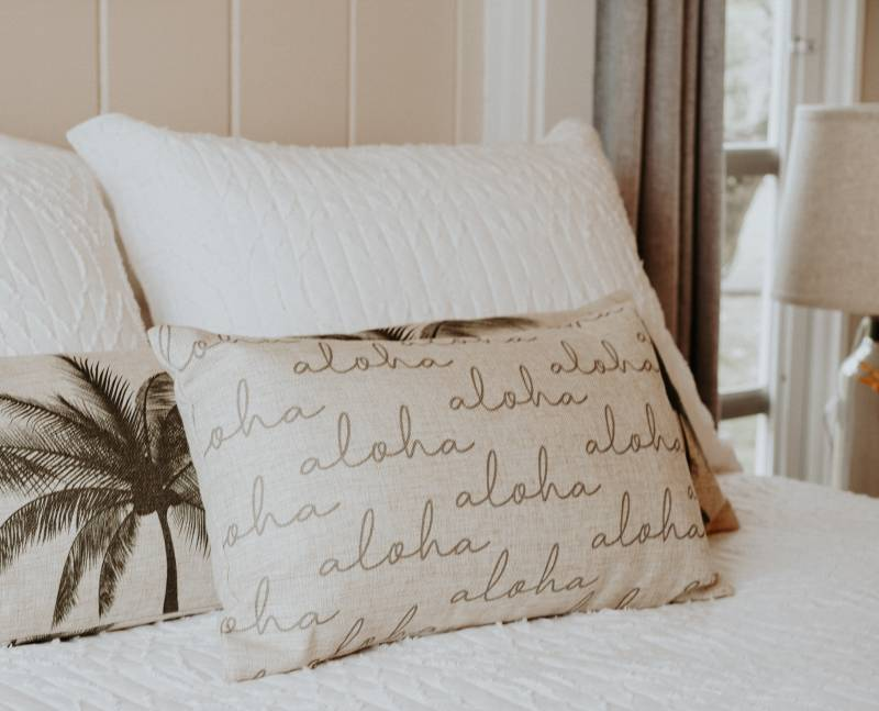 pillow with repeating aloha pattern