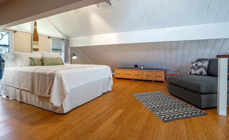 large main bedroom with wood floors