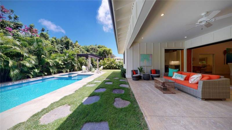 backyard with covered seating area and pool