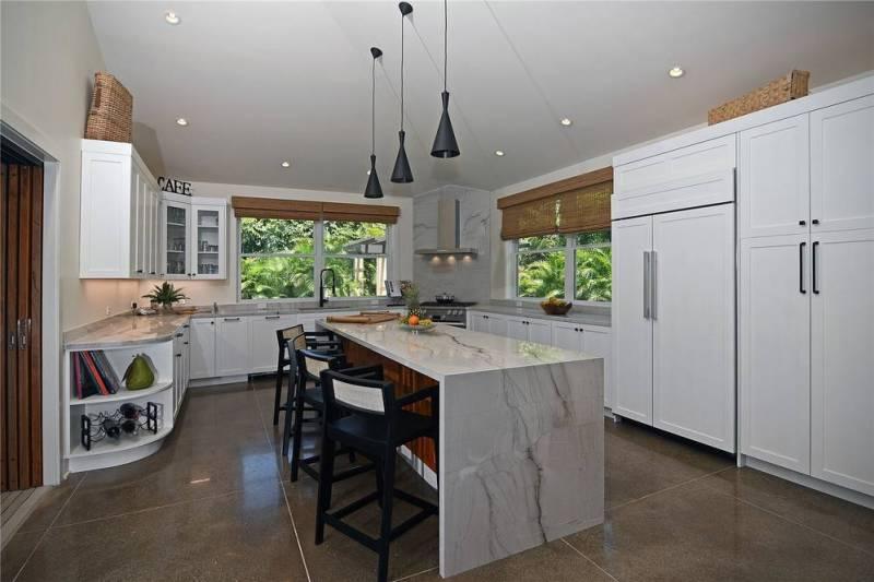 kitchen with waterfall stone island