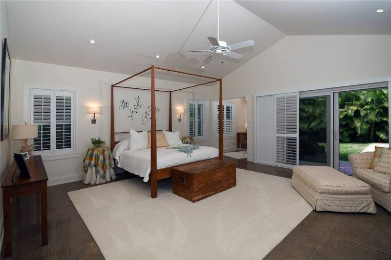 large bedroom with four poster bed