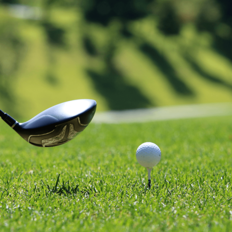 close up of golf club and ball